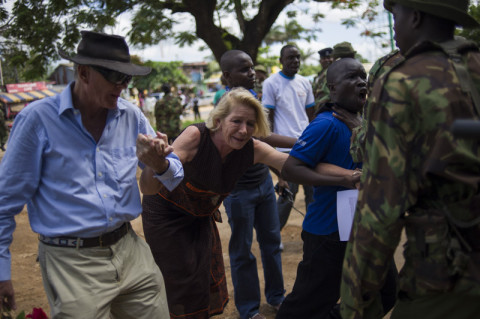 Please contact us for further information on this film.   Hilary Monson struggles as she is prevented from entering Ukunda police station by police belonging to the General Service Unit (GSU), a paramilitary wing of the Kenyan police force, in the coastal town of Ukunda on May 19, 2013. The mother of the late Alexander Monson, she scattered 365 roses between the Ukunda police station and the Palm Beach Hospital in the Kenyan coastal town, commemorating 365 days since her son died in police custody, for which she says she is still seeking justice. AFP PHOTO/PHIL MOORE